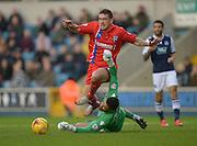 Cody McDonald is slain by Millwall keeper Jordan Archer