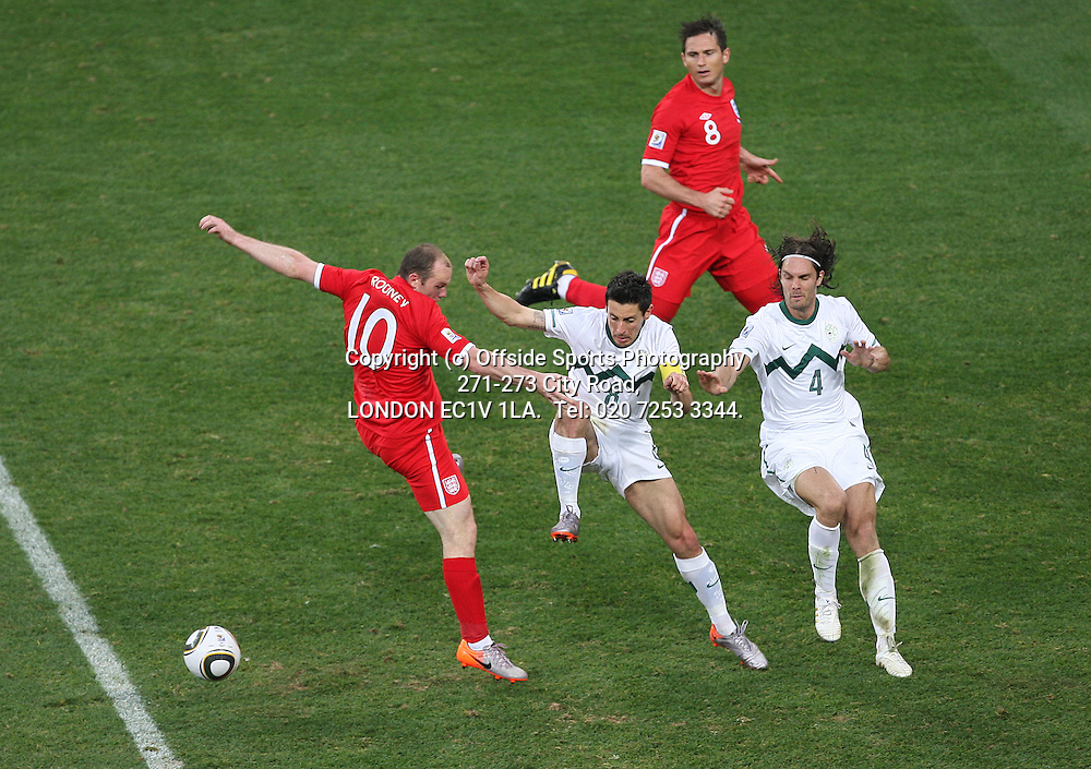 23/06/2010 World Cup. Slovenia v England.<br /> Wayne Rooney is blocked by the Slovenian defence.<br /> Photo: Mark Leech.