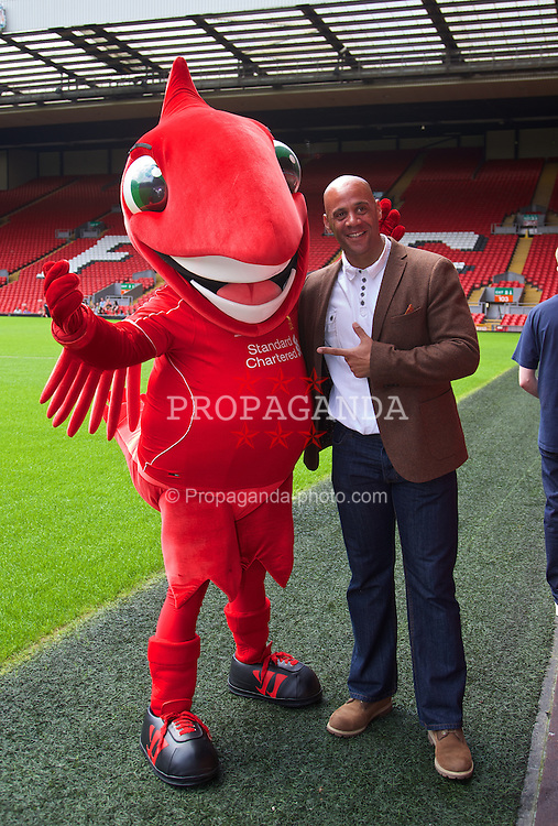 LIVERPOOL, ENGLAND - Saturday, June 21, 2014: Matt Simms with Liverpool FC mascot Mighty Red on a visit to Anfield during Day Three of the Liverpool Hope University International Tennis Tournament. (Pic by David Rawcliffe/Propaganda)