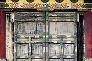 "Door pattern. Toshogu Shrine is the final resting place of Tokugawa Ieyasu, the founder of the Tokugawa Shogunate that ruled Japan for over 250 years until 1868. Ieyasu is enshrined at Toshogu as the deity Tosho Daigongen, ""Great Deity of the East Shining Light"". Initially a relatively simple mausoleum, Toshogu was enlarged into the spectacular complex seen today by Ieyasu's grandson Iemitsu during the first half of the 1600s. The lavishly decorated shrine complex consists of more than a dozen buildings set in a beautiful forest. Countless wood carvings and large amounts of gold leaf were used to decorate the buildings in a way not seen elsewhere in Japan. Toshogu contains both Shinto and Buddhist elements, as was common until the Meiji Period when Shinto was deliberately separated from Buddhism. Toshogu is part of Shrines and Temples of Nikko UNESCO World Heritage site."