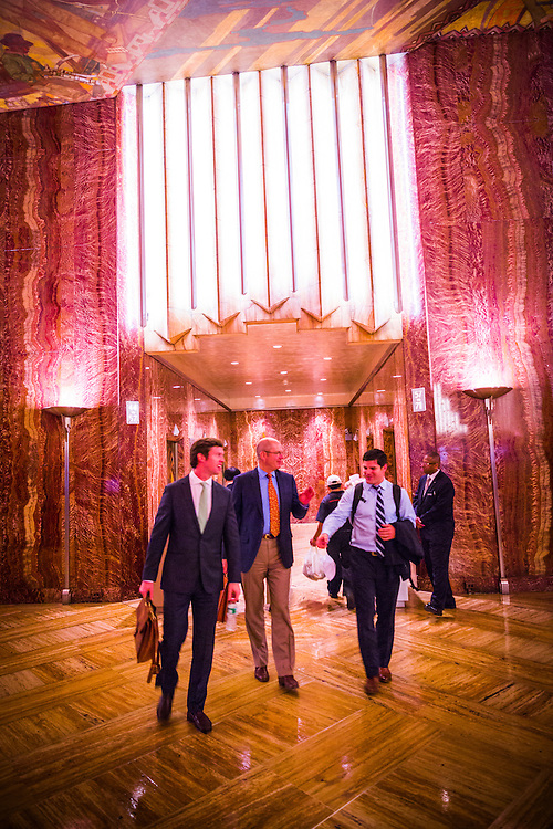 Men leaving the elevators in the red, Moroccan marble-clad, Art Deco lobby of the Chrysler Building