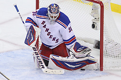May 19, 2012; Newark, NJ, USA; New York Rangers goalie Henrik Lundqvist (30) makes a save during the second period in game three of the 2012 Eastern Conference Finals at the Prudential Center.