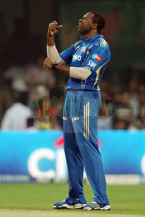 Kieron Pollard celebrates the wicket of AB de Villiers during match 62 of the the Indian Premier League ( IPL) 2012  between The Royal Challengers Bangalore and the Mumbai Indians held at the M. Chinnaswamy Stadium, Bengaluru on the 14th May 2012..Photo by Jacques Rossouw/IPL/SPORTZPICS