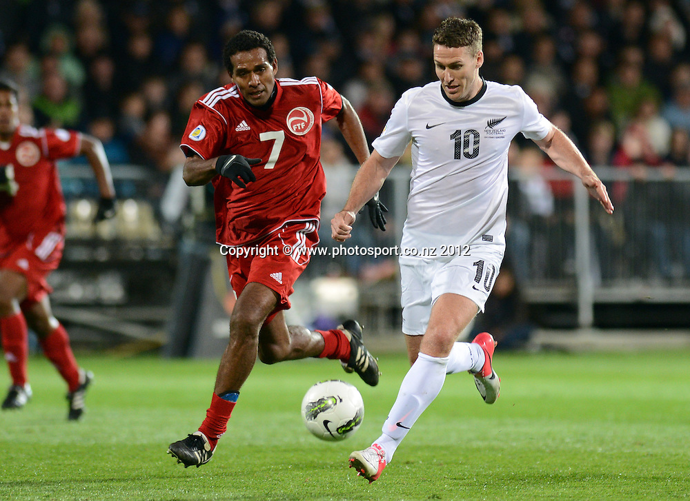 Chris Killen and Pierre Kugogne battle for the ball. New Zealand All Whites v Tahiti. FIFA World Cup Qualifier Football match at AMI Stadium. Christchurch, New Zealand. Tuesday 16 October 2012. Photo: Andrew Cornaga/photosport.co.nz