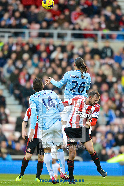 Picture by Ian Wadkins/Focus Images Ltd +44 7877 568959<br /> 10/11/2013<br /> Martin Demichelis of Manchester City wins the header during the Barclays Premier League match at the Stadium Of Light, Sunderland.
