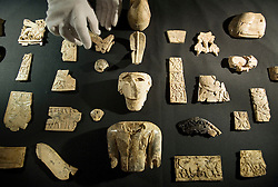 © licensed to London News Pictures.  28/06/2011. London, UK. The newly acquired 3,000 year old Nimrud Ivories on display at the British Museum today (28/06/2011) as part of the British Museum annual review. The largest acquisition by the museum since the Second World War, the Nimrud Ivories date from the 9th to 7th Century BC were discovered in the city of Nimrud in modern day Iraq and excavated by the British Institute for Study of Iraq. See special instructions. Photo credit should read: Ben Cawthra/LNP