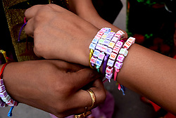 August 6, 2017 - Kolkata, West Bengal, India - Indian women activist ties friendship band to the pedestrian in the occasion of Friendship Day on August 6, 2017 in Kolkata. Friendship Day observes on first Sunday of August in India. (Credit Image: © Saikat Paul/Pacific Press via ZUMA Wire)