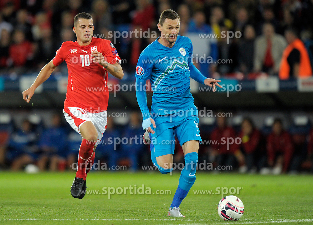 05.09.2015, St. Jakob Park, Basel, SUI, UEFA Euro 2016 Qualifikation, Schweiz vs Slowenien, Gruppe E, im Bild Granit Xhaka (SUI) gegen Milivoje Novakovic (SLO) // during the UEFA EURO 2016 qualifier group E match between Switzerland and Slovenia at the St. Jakob Park in Basel, Switzerland on 2015/09/05. EXPA Pictures &copy; 2015, PhotoCredit: EXPA/ Freshfocus/ Steffen Schmidt<br /> <br /> *****ATTENTION - for AUT, SLO, CRO, SRB, BIH, MAZ only*****