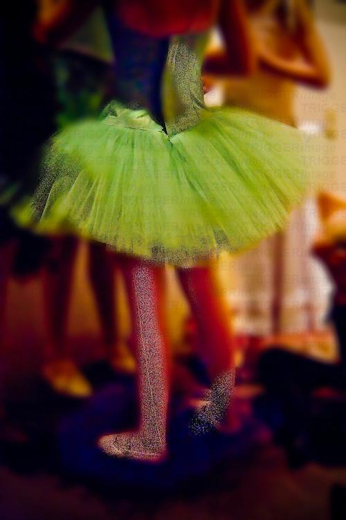 Ballet dancer in green tutu..