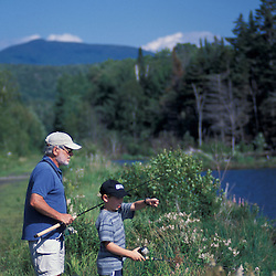 Randolph, NH.A young boy and his grandfather try their luck at fishing on a beaver pond in New Hampshire's White Mountains.