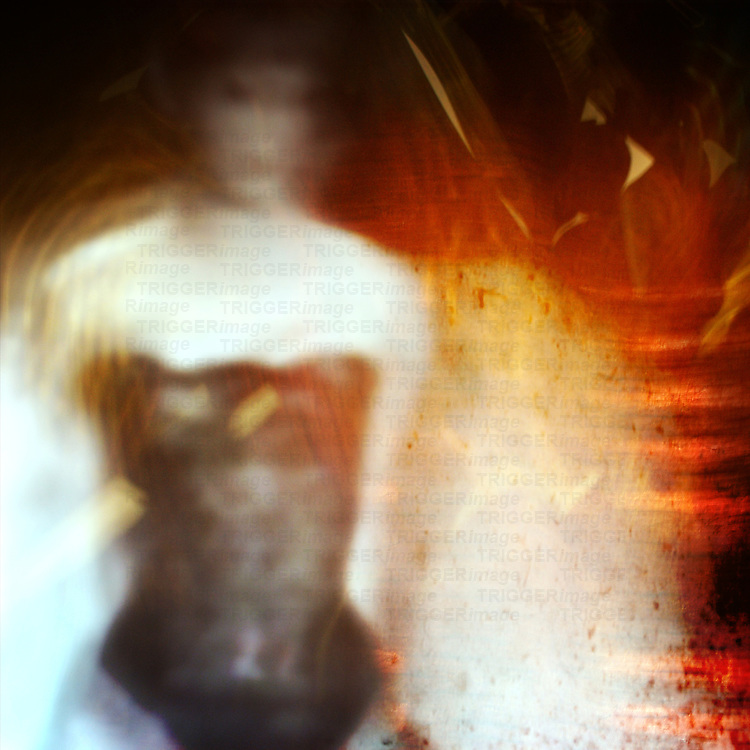 blurred image of a woman in a corset with colors swirling around her