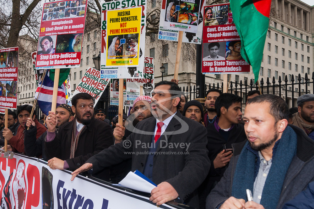 "London, February 10th 2015. Scores of UK Bangladeshis from  Save Bangladesh demonstrate outside Downing Street ahead of handing a letter to David Cameron appealing for him to put pressure on the ruling Awami League to hold free and fair elections and to end ""extra-judicial killings"" and political violence. PICTURED: Save Bangladesh Coordinator Barrister Abu Baker Molla speaks after delivering his message to No. 10."