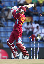 © Licensed to London News Pictures. 01/10/2012. West Indian Sunil Narine get bowled during the T20 Cricket World super 8's match between New Zealand Vs West Indies at the Pallekele International Stadium Cricket Stadium, Pallekele. Photo credit : Asanka Brendon Ratnayake/LNP