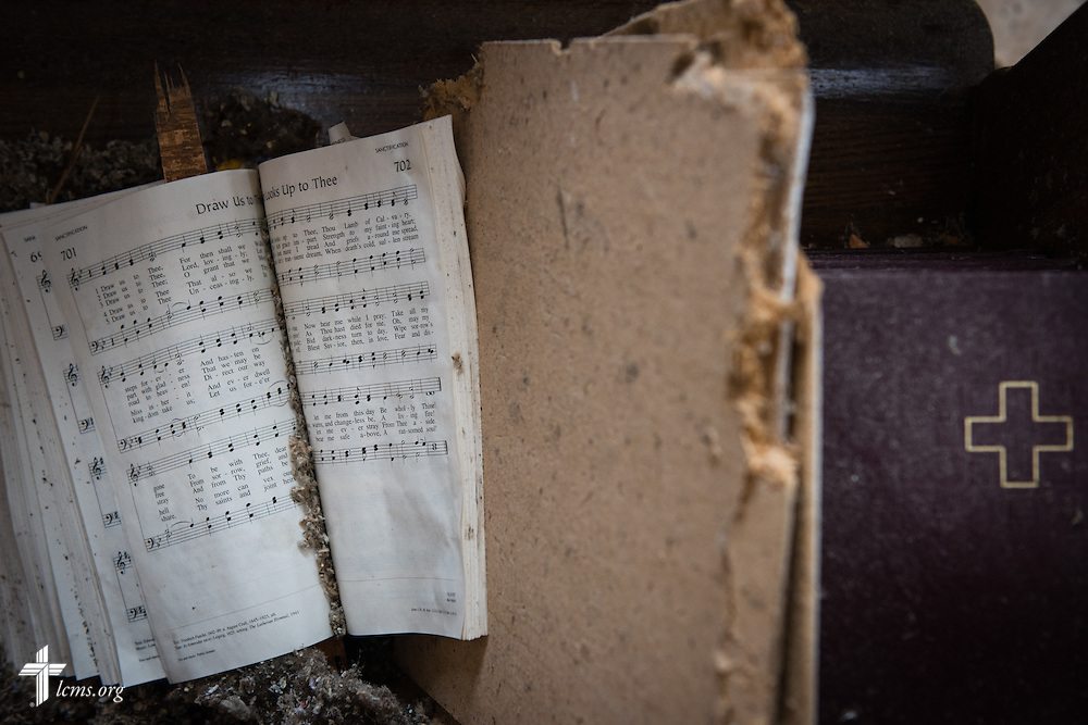Damaged Lutheran Service Books lay in the pews of Zion Lutheran Church on Monday, May 11, 2015, in Delmont, S.D. A tornado swept through the area the previous day and destroyed the church and nearby buildings. LCMS Communications/Erik M. Lunsford