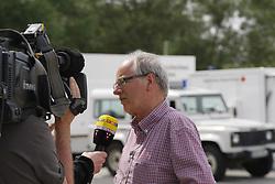 Hitzackers Museumsdirektor Klaus Lehmann während des Elbhochwassers 2013 in Lüchow-Dannenberg. <br /> <br /> Ort: Hitzacker<br /> Copyright: Karin Behr<br /> Quelle: PubliXviewinG