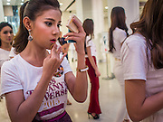 25 MARCH 2015 - BANGKOK, THAILAND: A contestant gets her makeup touched up during the first round of the Miss Tiffany's contest at CentralWorld, a large shopping mall in Bangkok. Miss Tiffany's Universe is a beauty contest for transgender contestants; all of the contestants were born biologically male. The final round will be held on May 8 in the beach resort of Pattaya. The final round is televised of the  Miss Tiffany's Universe contest is broadcast live on Thai television with an average of 15 million viewers.     PHOTO BY JACK KURTZ