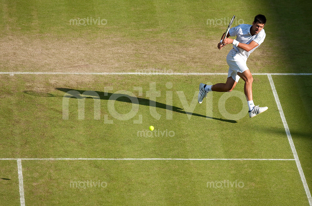 Novak Djokovic (SRB) plays against Taylor Dent (USA) on Centre Court. The Wimbledon Championships 2010 The All England Lawn Tennis & Croquet Club  Day 3 Wednesday 23/06/2010