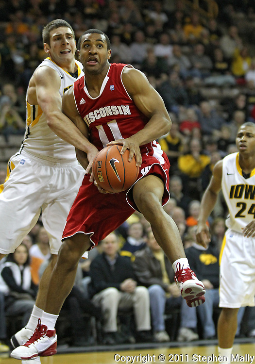 February 09 2011: Wisconsin Badgers guard Jordan Taylor (11) looks to put up a shot as Iowa Hawkeyes guard/forward Eric May (25) defends during the first half of an NCAA college basketball game at Carver-Hawkeye Arena in Iowa City, Iowa on February 9, 2011. Wisconsin defeated Iowa 62-59.