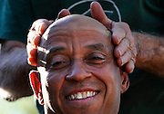 Client Jeffery Pettiford of Hartford, receives a massage of after-shave from from Anthony Cymerys in Hartford, Conn., Wednesday, May 1, 2013.