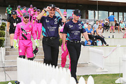 Umpires Billy Bowden (L) and Shaun Haig (R) lead out the players on to Bay Oval for the Burger King Super Smash Twenty20 cricket match Knights v Stags played at Bay Oval, Mount Maunganui, New Zealand on Wednesday 27 December 2017.<br /> <br /> Copyright photo: &copy; Bruce Lim / www.photosport.nz