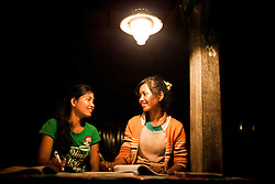Two young cambodian girls doing their homework, Svay Rieng Province, Cambodia, Southeast Asia
