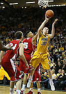 January 19 2013: Iowa Hawkeyes forward Aaron White (30) puts up a shot during the first half of the NCAA basketball game between the Wisconsin Badgers and the Iowa Hawkeyes at Carver-Hawkeye Arena in Iowa City, Iowa on Sautrday January 19 2013. Iowa defeated Wisconsin 70-66.