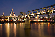 Millenium Bridge over the River Thames at dusk from the South Bank looking towards St Paul's Cathedral, London, Uk