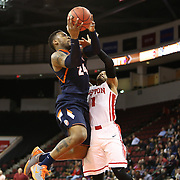 Rayvonte Rice #24 of the Illinois Fighting Illini fights past Maurice Watson Jr. #1 of the Boston University Terriers for a shot during the NIT First Round game at Agganis Arena on March 19, 2014 in Boston, Massachusetts . (Photo by Elan Kawesch)
