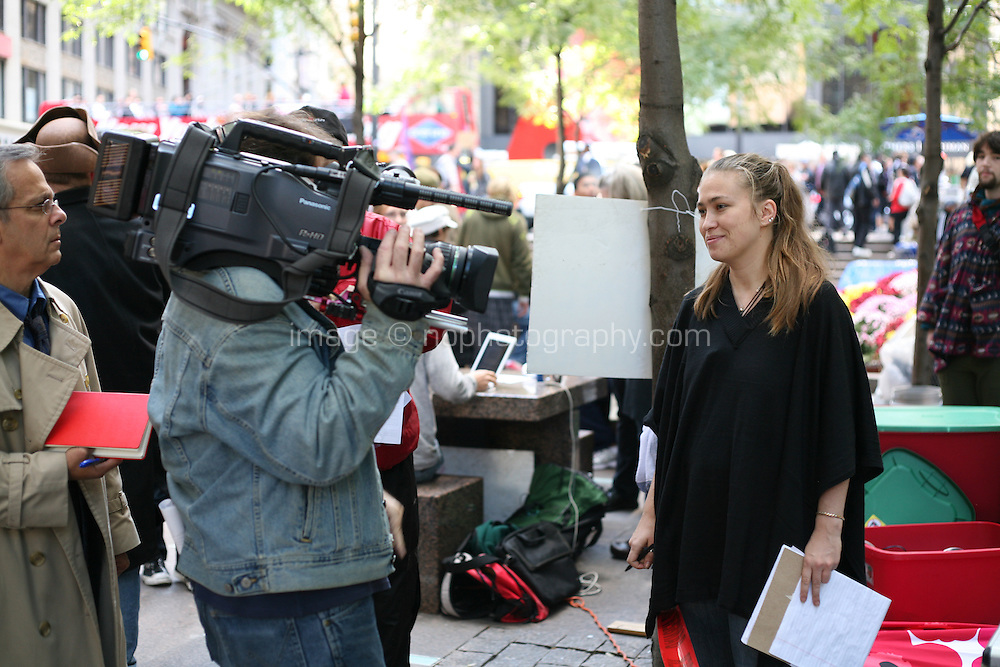 Media with the Occupy Wall Street protesters at Zuccotti Park in the financial district New York