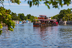 A paddle steamer turns around on the River Thames at Old Windsor, Berkshire. Old Windsor, Berkshire, July 05 2019.