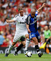 Photo: Richard Lane/Richard Lane Photography. SV Hamburg v Real Madrid. Emirates Cup. 02/08/2008. Real's Guti is challenged by Hamburg' Nigel De Jong.