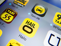 Detail of iPhone screen with Hailo mobile app for booking taxis