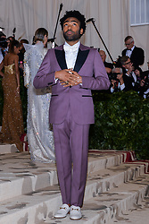 Donald Glover walking the red carpet at The Metropolitan Museum of Art Costume Institute Benefit celebrating the opening of Heavenly Bodies : Fashion and the Catholic Imagination held at The Metropolitan Museum of Art  in New York, NY, on May 7, 2018. (Photo by Anthony Behar/Sipa USA)