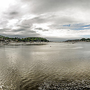 A panorama of the River Conwy from along Conwy Road, with the castle at far left of frame and the town on the far bank in center of frame. Conwy Castle is a medieval castle built by Edward I in the late 13th century. It forms part of a walled town of Conwy and occupies a strategic point on the River Conwy. It is listed as a World Heritage Site.