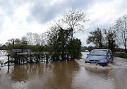 © Licensed to London News Pictures. 29/04/2012. Stondon Massey, UK . A car drives through flooding in Stondon Massey, Essex. Torrential rain has lead to flooding in parts of the country today 29 April 2012. Photo credit : Stephen Simpson/LNP