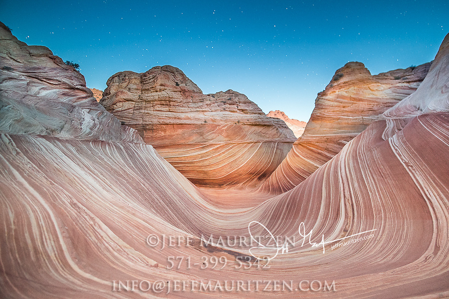 Nighttime stars above the Wave sandstone rock formation, located in Coyote Buttes North, Paria Canyon, Vermillion Cliffs Wilderness.