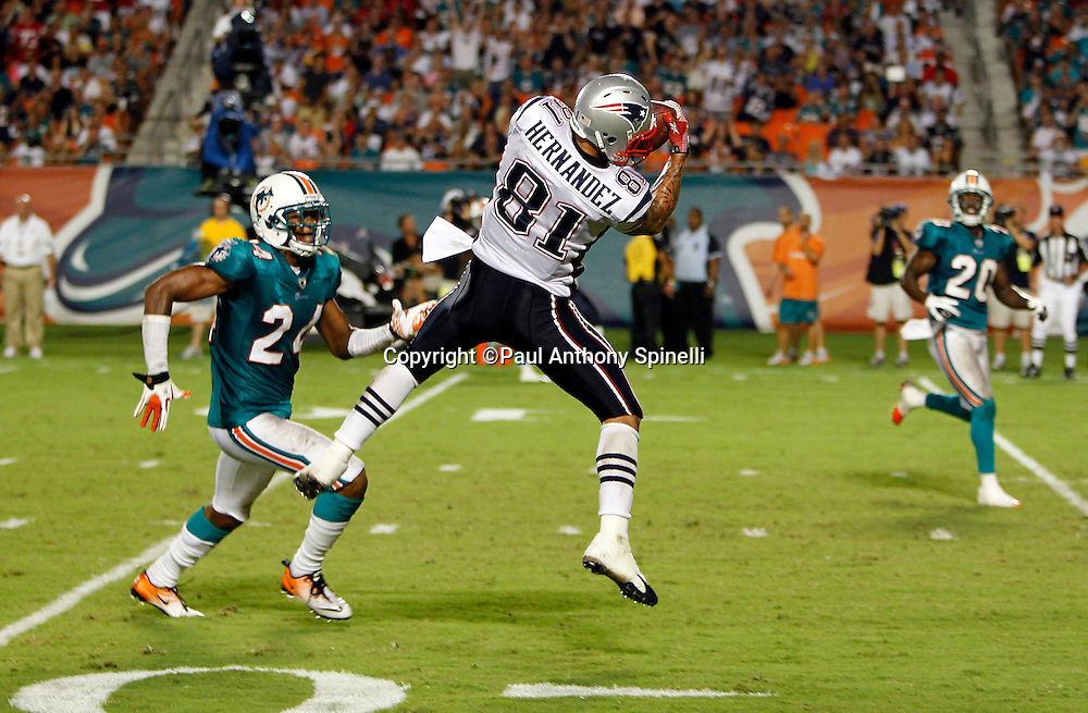 New England Patriots tight end Aaron Hernandez (81) leaps and catches a pass while covered by Miami Dolphins defensive back Sean Smith (24) during the NFL week 1 football game against the Miami Dolphins on Monday, September 12, 2011 in Miami Gardens, Florida. The Patriots won the game 38-24. ©Paul Anthony Spinelli