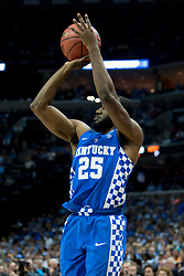 Kentucky guard Dominique Hawkins makes a three point basket in the first half. <br /> <br /> The University of Kentucky hosted the University of North Carolina in a 2017 NCAA D1 Men's South Regional Championship, Sunday, March 26, 2017 at FedExForum in Memphis.