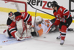 May 3, 2012; Newark, NJ, USA;  New Jersey Devils goalie Martin Brodeur (30) makes a save on Philadelphia Flyers left wing Scott Hartnell (19) while New Jersey Devils defenseman Marek Zidlicky (2) defends during the second period in game three of the 2012 Eastern Conference semifinals at the Prudential Center.