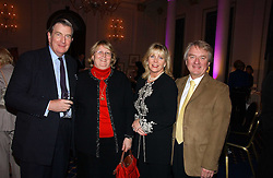 Left to right, MAJOR SIR MICHAEL & LADY PARKER and MR & MRS MIKE BANNISTER he was the former chief pilot for Concorde at a reception to launch Angel themed Christmas Cards and view an exhibition of the original art work by Gordon King with proceeds going to the Caron Keating Foundation  held at the Langham Hotel, Portland Place, London on 20th November 2006.<br />