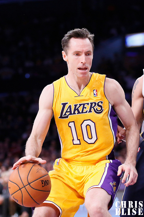 11 February 2014: Los Angeles Lakers point guard Steve Nash (10) dribbles during the Utah Jazz 96-79 victory over the Los Angeles Lakers at the Staples Center, Los Angeles, California, USA.