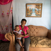 Elisa sits in her home with her baby daughter, Isabela*, in the Los Calzones in the San Juan De La Maguana Province community, that was flooded when Hurricane Irma hit the Dominican Republic, September 13, 2017. The river is the only source of water for mot of the community, and became so polluted that the government closed the pipe connection from the river to the community for seven days following the hurricane. The area is prone to diseases such as mosquitos, increasing cases of dengue, chikungunya, zika and others.