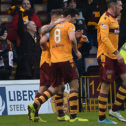 Carl McHugh (Motherwell) celebrates with team mates after scoring the winner during the Scottish Cup quarter final between Motherwell and Hearts at Fir Park, where the home side made it into the semi final draw with a win.<br /> <br /> (c) Dave Johnston | sportPix.org.uk