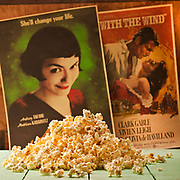 Classic film concept - a pile of popcorn with two classic film posters in the background