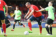 Jon Parkin of York City (9) works space to get a shot off and scores a goal to make the score 1-1 during the Vanarama National League North match between York City and Curzon Ashton at Bootham Crescent, York, England on 18 August 2018.