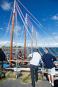 Spectators viewing the beautiful Galwya Hookers from the pier at Parkmore during  the Crinniu na mBad (Gathering of the boats) Festival  in Kinvara Co. Galway at the weekend featuring Galway hookers racing across the bay. Photo:Andrew Downes.