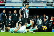 Simon Francis (#2) of Bournemouth slides in to win the ball from Kenedy (#15) of Newcastle United during the Premier League match between Newcastle United and Bournemouth at St. James's Park, Newcastle, England on 10 November 2018.