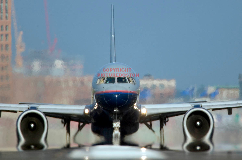 "Various airliners flying in and around Boston's Logan International Airport. Very long lens. NO trickery or photoshop. All photos are ""real time"" with no trickery or multiple exposure. Here, a Boeing 757 on departure..."