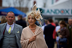 LIVERPOOL, ENGLAND - Thursday, April 6, 2017: A race goer wearing a gold fascinator, during The Opening Day on Day One of the Aintree Grand National Festival 2017 at Aintree Racecourse. (Pic by David Rawcliffe/Propaganda)