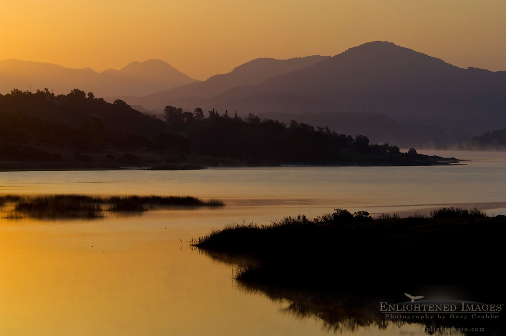 Morning sunrise light over Lake Casitas and rolling hills near Ojai, California